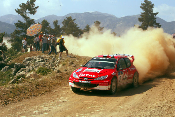 Richard Burns in action in the Peugeot 206 WRC, Acropolis Rally 2003.
