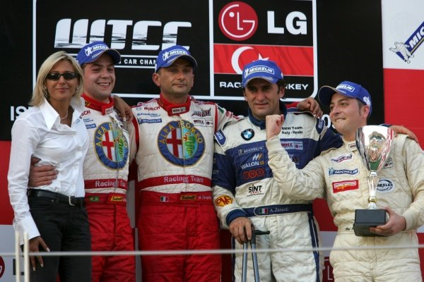 Race 2 podium and results: 1st: Gabriele Tarquini (ITA) Alfa Romeo Racing Team, centre. 2nd: Augusto Farfus Jr (BRA) Alfa Romeo Racing Team, left. 3rd: Alessandro Zanardi (ITA) BMW Italy Spain, right. With Monica Sipsz (ITA) Alfa Romeo Racing Team Manager, left and Independent's Cup winner Marc Hennericci (GER), right. FIA WTCC, Rd8, Istanbul, Turkey, 18 September 2005. DIGITAL IMAGE