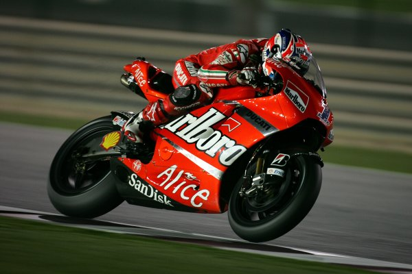 2008 MotoGP. Losail, Qatar. 7th - 9th March 2008. Rd 1. Casey Stoner, Ducati, 1st position, action. World Copyright: Martin Heath/LAT Photographic. Ref: Digital Image Only.