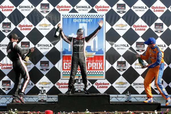 1 June, 2014, Detroit, Michigan, USA Will Power, Helio Castroneves and Charlie Kimball with Champagne ©2014, Michael L. Levitt LAT Photo USA