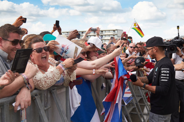 Silverstone Circuit, Northamptonshire, England. Saturday 4 July 2015. Lewis Hamilton, Mercedes AMG, signs autographs for fans. World Copyright: Steve Etherington/LAT Photographic ref: Digital Image SNE18866