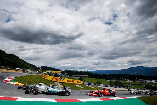 Red Bull Ring, Spielberg, Austria. Sunday 21 June 2015. Nico Rosberg, Mercedes F1 W06 Hybrid, passes Lewis Hamilton, Mercedes F1 W06 Hybrid, at the start. World Copyright: Steven Tee/LAT Photographic. ref: Digital Image _X0W9295