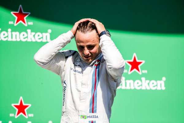 Interlagos, Sao Paulo, Brazil. Sunday 12 November 2017. Felipe Massa, Williams Martini Racing, waves from the podium whilst celebrating after his final home Grand Prix. World Copyright: Charles Coates/LAT Images  ref: Digital Image AN7T7617