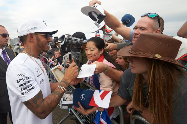 Silverstone, Northamptonshire, UK.  Sunday 16 July 2017. Lewis Hamilton, Mercedes AMG, signs autograhs for fans. World Copyright: Steve Etherington/LAT Images  ref: Digital Image SNE10694