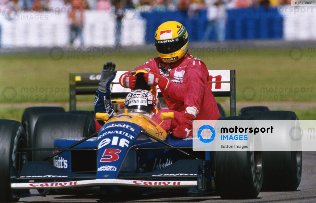 Race winner Nigel Mansell (GBR) Williams FW14 gives fourth place finisher Ayrton Senna (BRA) McLaren a lift back to the pits after the Brazilian ran put of fuel on the final lap. Formula One World Championship, Rd8, British Grand Prix, Silverstone, England, 14 July 1991.  Catalogue Ref.: 10-183  Sutton Motorsport Images Catalogue