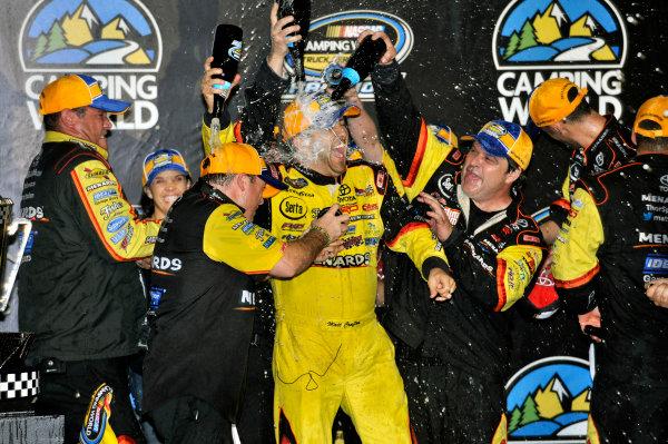 15 November, 2013, Homestead, Florida USA Matt Crafton celebrates winning the Truck Series Championship © 2013, Nigel Kinrade LAT Photo USA
