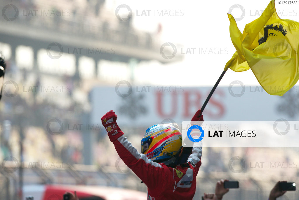 Shanghai International Circuit, Shanghai, China Sunday 14th April 2013 Fernando Alonso, Ferrari, 1st position, celebrates upon arrival in Parc Ferme. World Copyright: Andy Hone/LAT Photographic ref: Digital Image HONZ7778