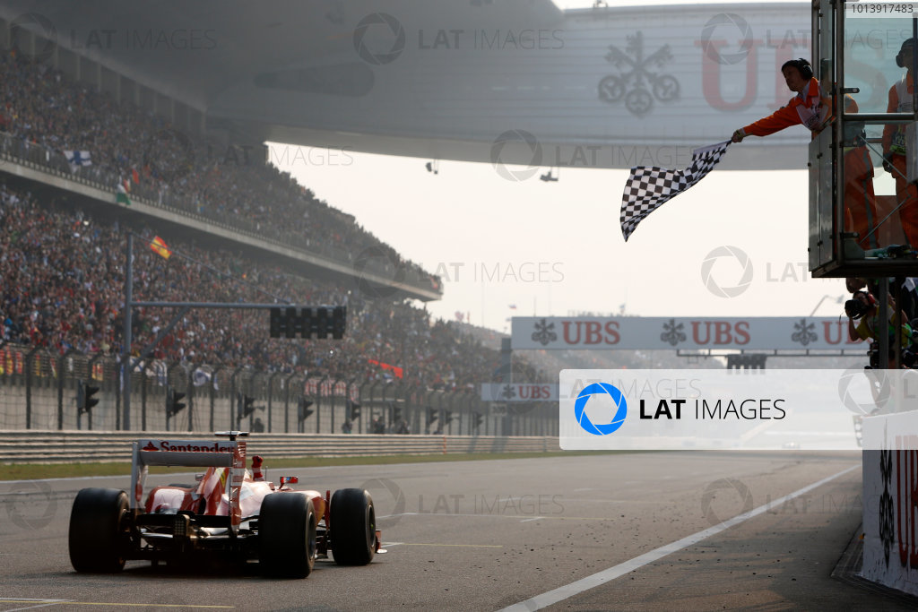 Shanghai International Circuit, Shanghai, China Sunday 14th April 2013 Fernando Alonso, Ferrari F138, takes the chequered flag for victory. World Copyright: Alastair Staley/LAT Photographic ref: Digital Image _R6T2288
