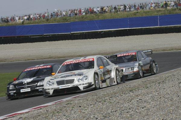 2005 DTM ChampionshipZandvoort, Netherlands. 27th - 28th August 2005Jamie Green (Salzgitter AMG-Mercedes C-Klasse) leads Laurent Aiello (Opel Vectra GTS V8) and Pierre Kaffer (Joest Racing Audi A4). Action.World Copyright: Andre Irlmeier / LAT Photographicref: Digital Image Only