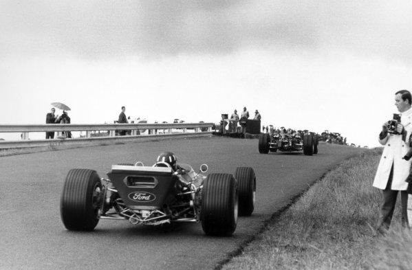 1968 Dutch Grand Prix.Zandvoort, Holland. 23 June 1968.Jo Siffert, Lotus 49-Ford, retired, leads Graham Hill, Lotus 49B-Ford, 9th position, action.World Copyright: LAT PhotographicRef: Motor b&w print