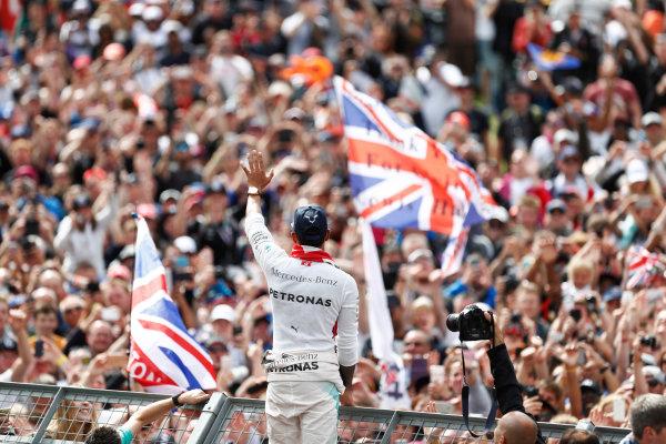 Silverstone, Northamptonshire, UK Sunday 10 July 2016. Lewis Hamilton, Mercedes AMG, 1st Position, celebrates with the British fans. World Copyright: Dunbar/LAT Photographic ref: Digital Image _V2I1798