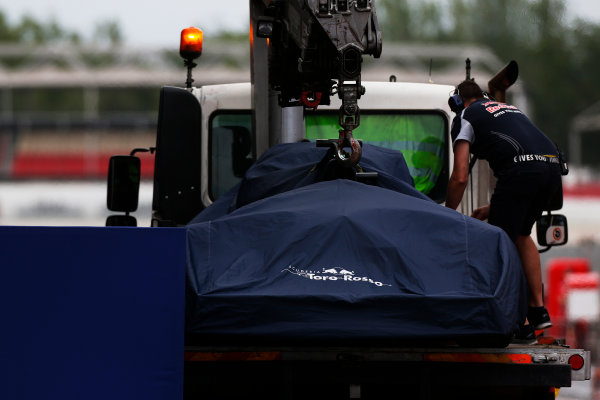 Circuit de Catalunya, Barcelona, Spain.  Wednesday 18 May 2016.  The Toro Rosso STR11 Ferrari of Daniil Kvyat under a cover is returned to the pits on a recovery truck.  World Copyright: Sam Bloxham/LAT Photographic ref: Digital Image _R6T1945
