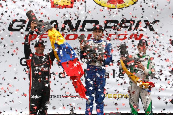 27-29 June, 2014, Houston, Texas USA Carlos Huertas, Juan Pablo Montoya and Carlos Munoz celebrate on the podium ©2014, Phillip Abbott LAT Photo USA