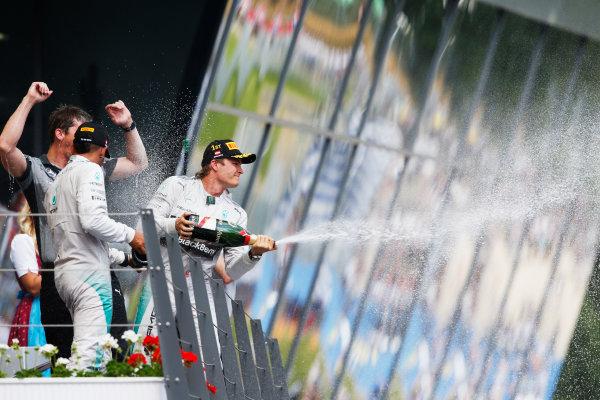 Red Bull Ring, Spielberg, Austria. Sunday 22 June 2014. Nico Rosberg, Mercedes AMG, 1st Position, celebrates on the podium. World Copyright: Steven Tee/LAT Photographic. ref: Digital Image _X0W0909