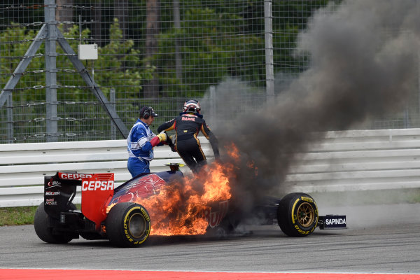 Hockenheimring, Hockenheim, Germany. Sunday 20 July 2014. Daniil Kvyat, Toro Rosso STR9 Renault, leaps out of his burning car. World Copyright: Steve Etherington/LAT Photographic. ref: Digital Image GER-RACE-3085
