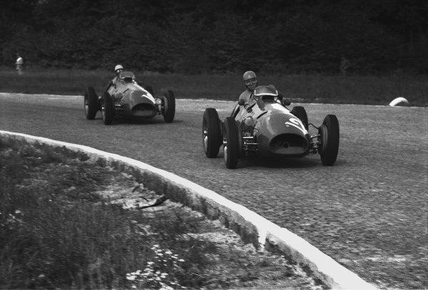 1952 Italian Grand Prix. Monza, Italy. 7th September 1952. Alberto Ascari (Ferrari 500), 1st position, leads Giuseppe Farina (Ferrari 500), 4th position, action.  World Copyright: LAT Photographic. Ref:  52 - 48 - 5A.