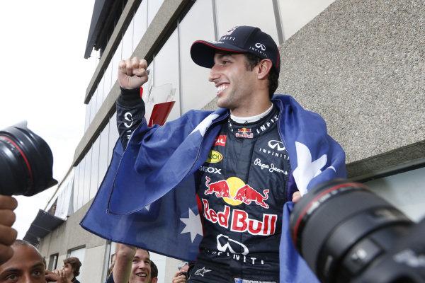 Circuit Gilles Villeneuve, Montreal, Canada. Sunday 8 June 2014. Daniel Ricciardo, Red Bull Racing, 1st Position, celebrates with his team. World Copyright: Alastair Staley/LAT Photographic. ref: Digital Image _79P1325