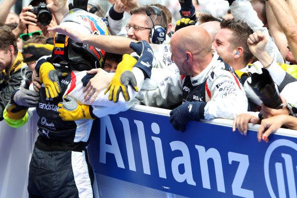 Circuit de Catalunya, Barcelona, Spain 13th May 2012 Pastor Maldonado, Williams F1 Team celebrates with his mechanics after winning the race. World Copyright:Glenn Dunbar/LAT Photographic ref: Digital Image CG8C5486