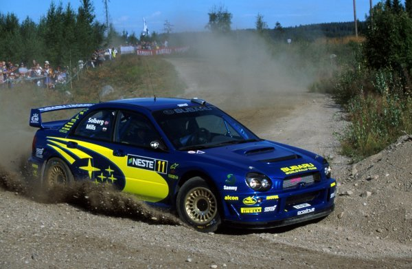 Petter Solberg (NOR) and Phil Mills (GBR) Subaru Impreza WRC.FIA World Rally Championship, Rd9, Neste Rally Finland, Finland. 8-11 August 2002.BEST IMAGE