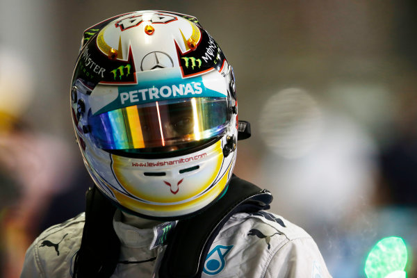 Yas Marina Circuit, Abu Dhabi, United Arab Emirates. Saturday 22 November 2014. Lewis Hamilton, Mercedes AMG, arrives in Parc Ferme after Qualifying. World Copyright: Steven Tee/LAT Photographic. ref: Digital Image _X0W0094