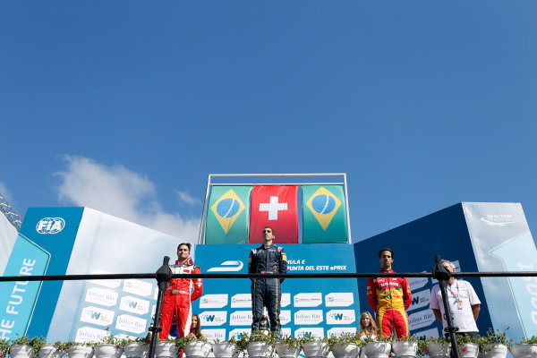 2014 FIA Formula E Championship. Punta del Este ePrix, Uruguay. Podium. Sebastien Buemi (SWI)/E.dams Renault - Spark-Renault SRT_01E (first position), Nelson Piquet Jr (BRA)/China Racing - Spark-Renault SRT_01E (second position) and Lucas di Grassi (BRA)/Audi Abt Sport - Spark-Renault SRT_01E (third position). Photo: Zak Mauger/LAT/FE ref: Digital Image _L0U1868