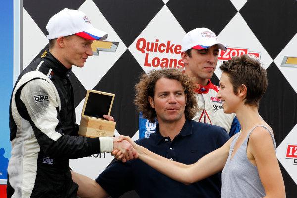 1 June, 2013, Detroit, Michigan, USA Winner Mike Conway receives a Shinola watch.  ©2013, Todd Davis LAT Photo USA