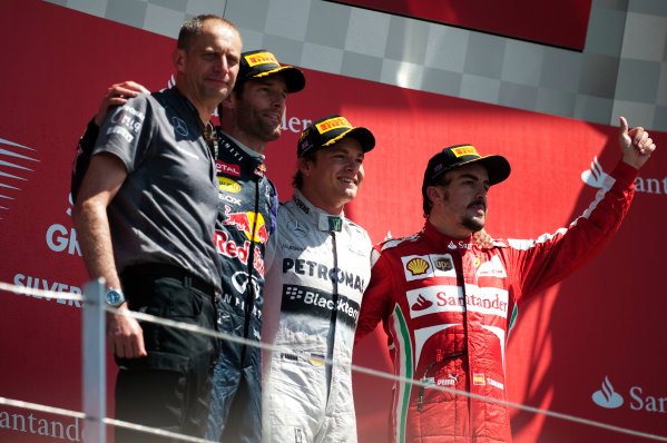 Silverstone, Northamptonshire, England 30th June 2013 Nico Rosberg, Mercedes AMG, 1st position, Mark Webber, Red Bull Racing, 2nd position, and Fernando Alonso, Ferrari, 3rd position, on the podium World Copyright: Chris Bird/  ref: Digital Image _CJB6823
