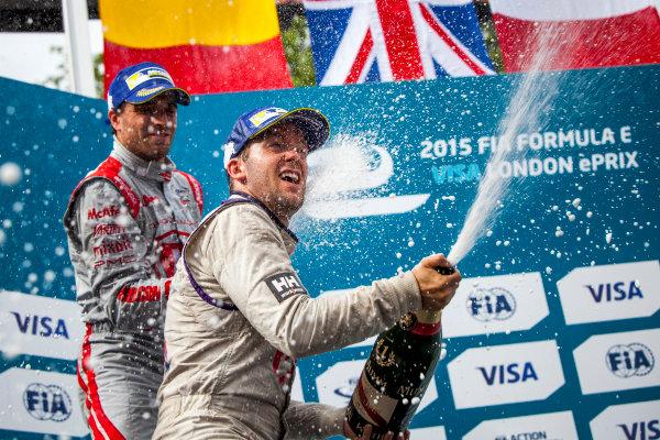 2014/2015 FIA Formula E Championship. London e-Prix, Battersea Park, London, UK. Sunday 28 June 2015. Sam Bird (GBR)/Virgin Racing - Spark-Renault SRT_01E and Jerome D'Ambrosio (BEL)/Dragon Racing - Spark-Renault SRT_01E on the podium. World Copyright: Zak Mauger/LAT Photographic/Formula E. ref: Digital Image _MG_0225