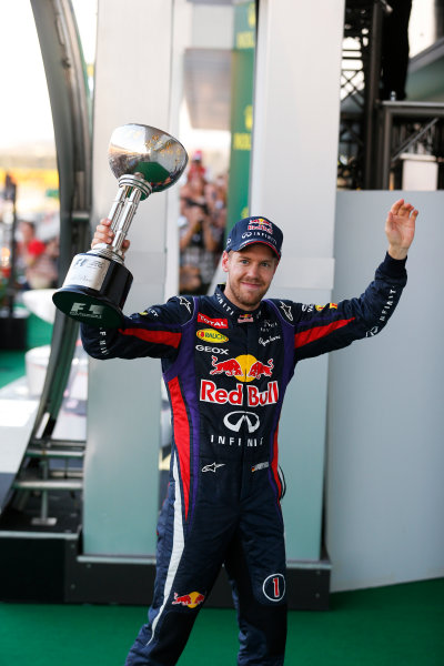Suzuka Circuit, Suzuka, Japan.  Sunday 13th October 2013. Sebastian Vettel, Red Bull Racing, 1st position, leaves the podium with his trophy.   World Copyright: Steven Tee/LAT Photographic  ref: Digital Image _C3I1223