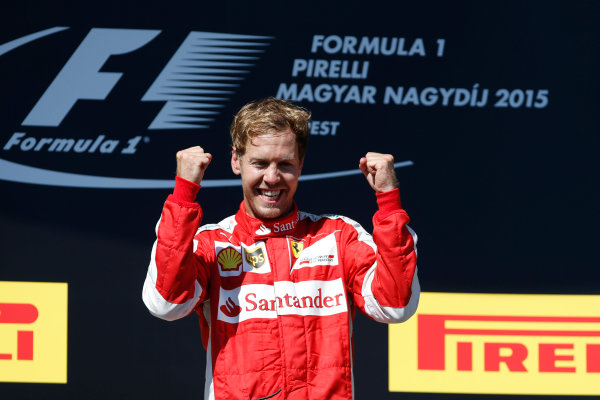 Hungaroring, Budapest, Hungary. Sunday 26 July 2015. Sebastian Vettel, Ferrari, celebrates his win on the podium. World Copyright: Glenn Dunbar/LAT Photographic ref: Digital Image _W2Q1026