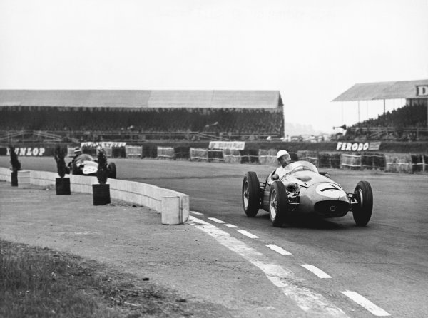 Silverstone, England. 14th July 1956. Stirling Moss (Maserati 250F), 8th position, action.  World Copyright: LAT Photographic Ref: Motor B/W Print.