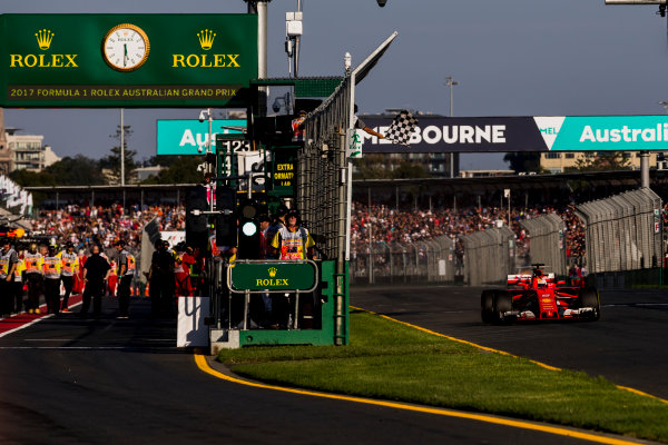 Albert Park, Melbourne, Australia. Sunday 26 March 2017. Sebastian Vettel, Ferrari SF70H, takes the chequered flag for victory. World Copyright: Zak Mauger/LAT Images ref: Digital Image _56I1693