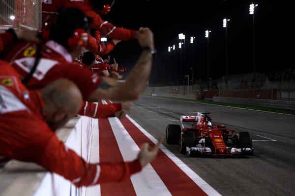 Bahrain International Circuit, Sakhir, Bahrain.  Sunday 16 April 2017. Sebastian Vettel, Ferrari SF70H, 1st Position, takes the victory to the delight of his team. World Copyright: Charles Coates/LAT Images ref: Digital Image _27I0752
