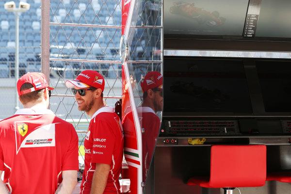 Sochi Autodrom, Sochi, Russia. Thursday 27 April 2017. Kimi Raikkonen, Ferrari speaks to Sebastian Vettel, Ferrari. on the pit wall World Copyright: Coates/LAT Images ref: Digital Image DJ5R0091