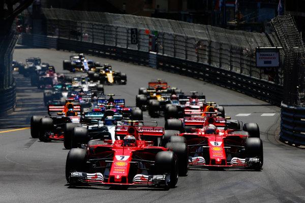 Monte Carlo, Monaco. Sunday 28 May 2017. Kimi Raikkonen, Ferrari SF70H, leads Sebastian Vettel, Ferrari SF70H, and Valtteri Bottas, Mercedes F1 W08 EQ Power+, at the start of the race. World Copyright: Andy Hone/LAT Images ref: Digital Image _ONZ0414