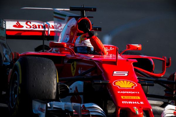 Race winner Sebastian Vettel (GER) Ferrari SF70-H celebrates at the end of the race at Formula One World Championship, Rd1, Australian Grand Prix, Race, Albert Park, Melbourne, Australia, Sunday 26 March 2017.