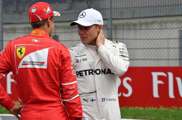 Sebastian Vettel (GER) Ferrari and pole sitter Valtteri Bottas (FIN) Mercedes AMG F1 after Qualifying at Formula One World Championship, Rd9, Austrian Grand Prix, Qualifying, Spielberg, Austria, Saturday 8 July 2017.