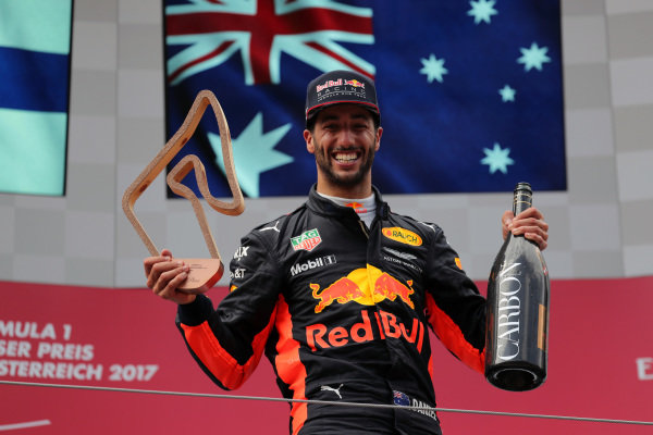 Daniel Ricciardo (AUS) Red Bull Racing celebrates on the podium with the trophy and the champagne at Formula One World Championship, Rd9, Austrian Grand Prix, Race, Spielberg, Austria, Sunday 9 July 2017.