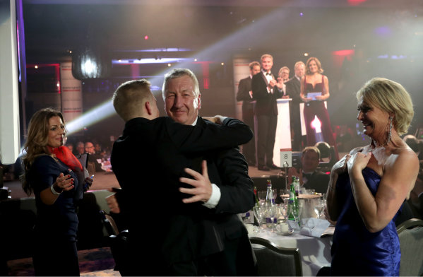 Aston Martin Autosport BRDC Young Driver Award winner Johnathan Hoggard celebrates with Fortec boss Richard Dutton, friends and family upon announcement