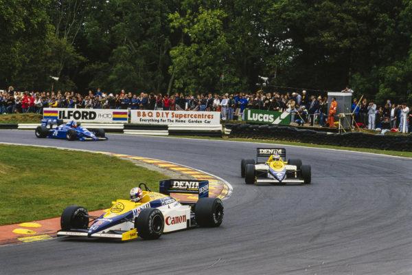 Nigel Mansell, Williams FW10 Honda, leads Keke Rosberg, Williams FW10 Honda, and Philippe Streiff, Ligier JS25 Renault.