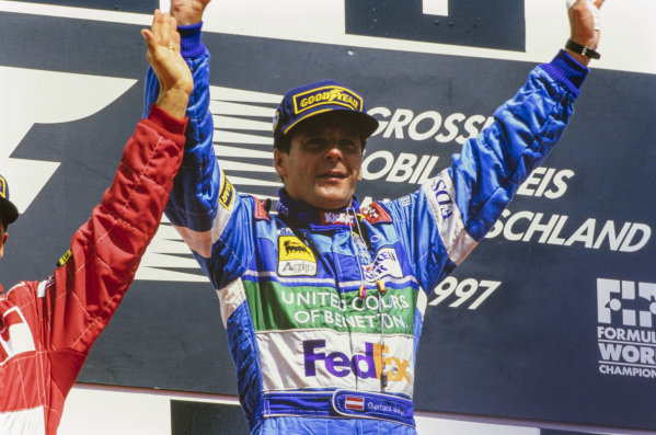 Gerhard Berger, 1st position, celebrates what would be his final victory on the podium.