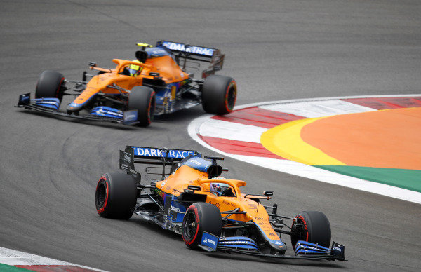 Daniel Ricciardo, McLaren MCL35M, leads Lando Norris, McLaren MCL35M