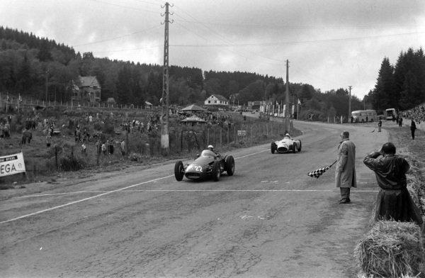 Luigi Villoresi, Maserati 250F, leads André Pilette, Ferrari D50, across the line.