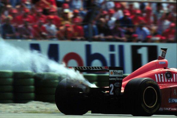 1996 German Grand Prix.Hockenheim, Germany.26-28 July 1996.Eddie Irvine (Ferrari F310) suffers an engine failure.World Copyright - LAT Photographic