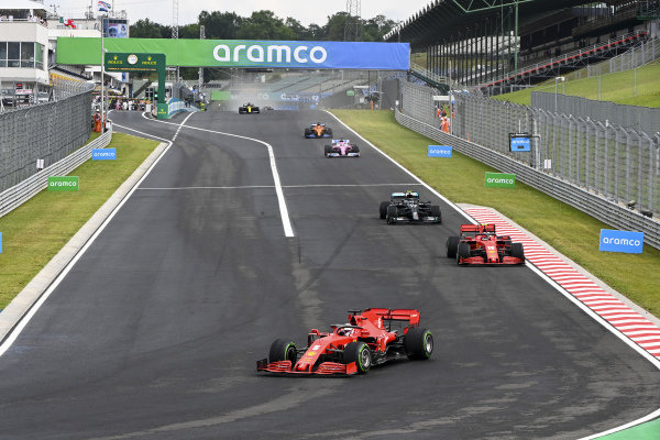Sebastian Vettel, Ferrari SF1000, leads Charles Leclerc, Ferrari SF1000, and Valtteri Bottas, Mercedes F1 W11 EQ Performance