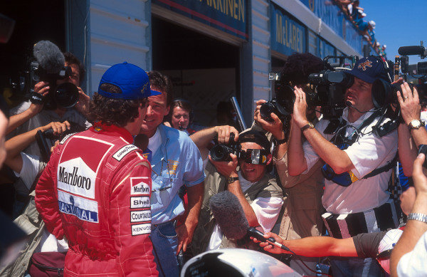 1993 Australian Grand Prix.Adelaide, Australia.5-7 November 1993.Ayrton Senna (McLaren Ford) always followed by the world's press, is interviewed by Barry Sheene.Ref-93 AUS 14.World Copyright - LAT Photographic