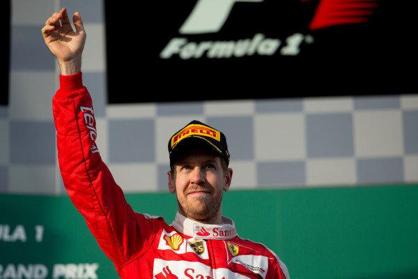 Sebastian Vettel (GER) Ferrari celebrates on the podium at Formula One World Championship, Rd1, Australian Grand Prix, Race, Albert Park, Melbourne, Australia, Sunday 20 March 2016.