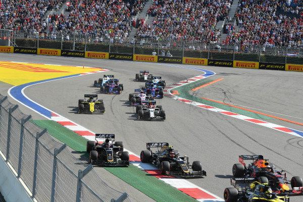 Nico Hulkenberg, Renault R.S. 19, leads Max Verstappen, Red Bull Racing RB15, Kevin Magnussen, Haas VF-19, Romain Grosjean, Haas VF-19, Antonio Giovinazzi, Alfa Romeo Racing C38, Daniel Ricciardo, Renault R.S.19, and the remainder of the field at the start