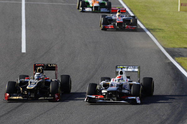 Kimi Raikkonen (FIN) Lotus E20 and Sergio Perez (MEX) Sauber C31 battle. Formula One World Championship, Rd15, Japanese Grand Prix, Race, Suzuka, Japan, Sunday 7 October 2012.  BEST IMAGE