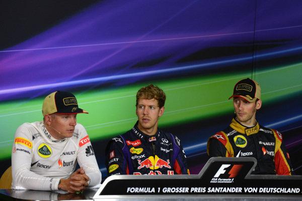 Results and post-race Press Conference: 1st Sebastian Vettel (GER) Red Bull Racing, centre. 2nd Kimi Raikkonen (FIN) Lotus F1, left. 3rd Romain Grosjean (FRA) Lotus F1, right. Formula One World Championship, Rd9, German Grand Prix, Race Day, Nurburgring, Germany, Sunday 7 July 2013.
